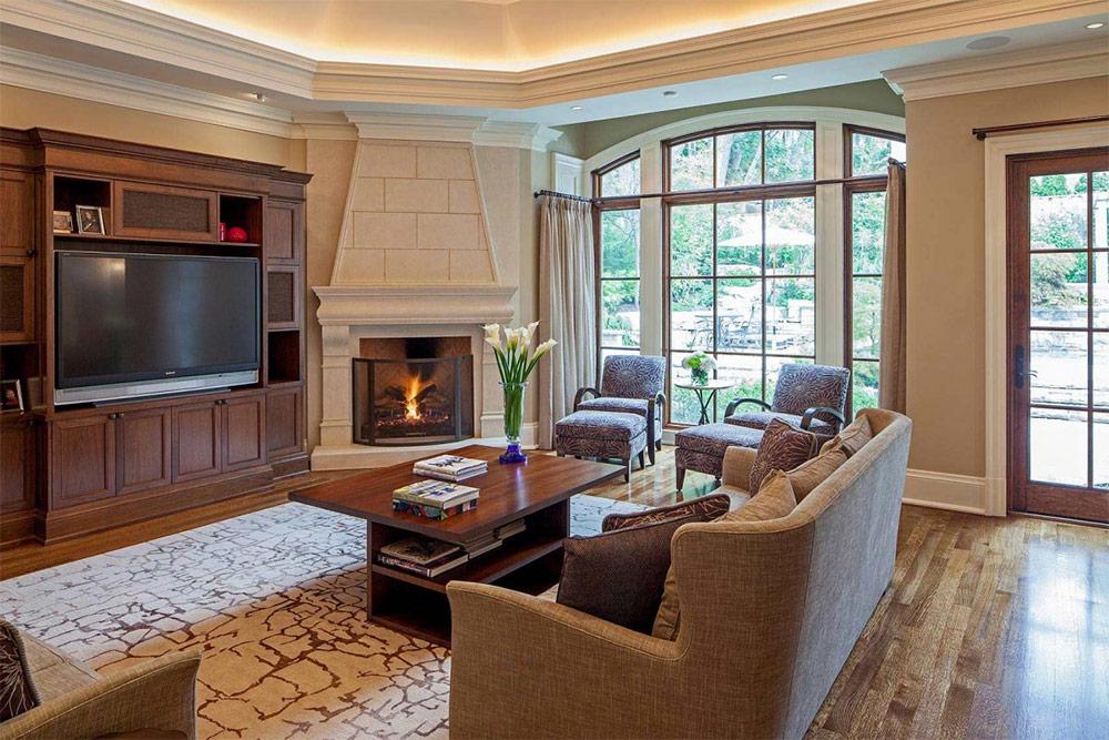Фото дизайна гостиной с угловым камином